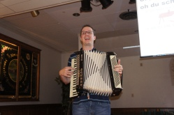Herr B. takes a risk and plays his accordion for Schnitzelbank song.